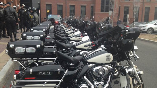 Hartford officers prepare to leave for MA. (WFSB photo)