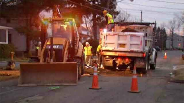 Crews worked to repair a water main break on Melrose Street in Glastonbury on Monday evening. (WFSB)