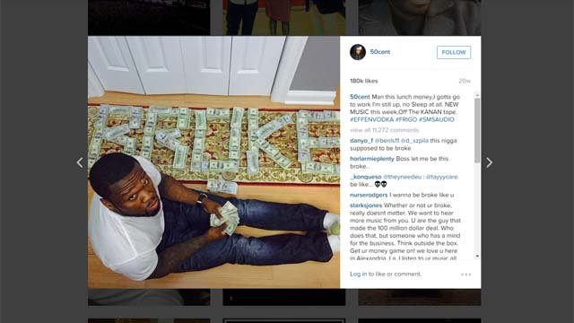 """Rapper 50 Cent appears in a photo on his Instagram in front of cash spelling out """"BROKE."""" (Instagram)"""