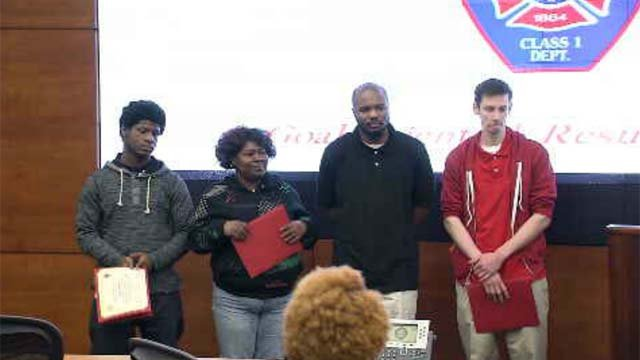 Four people, including a 15-year-old, are being hailed heroes after they rescued a 60-year-old woman from a burning home in Hartford over the weekend. (WFSB)