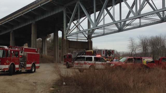 Some trespassers in the area of a railroad bridge in Groton halted some train service on Thursday afternoon. (WFSB)