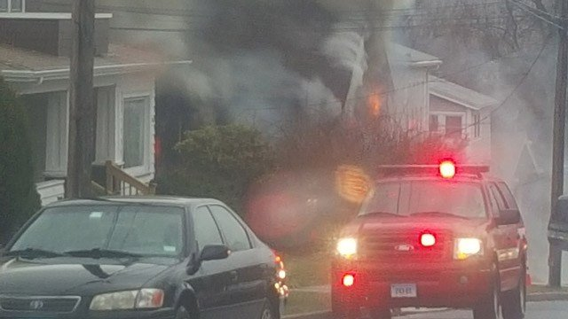 Crews responded to a house fire on George Street in Bristol. (Ben Dutkiewicz/iWitness photo)