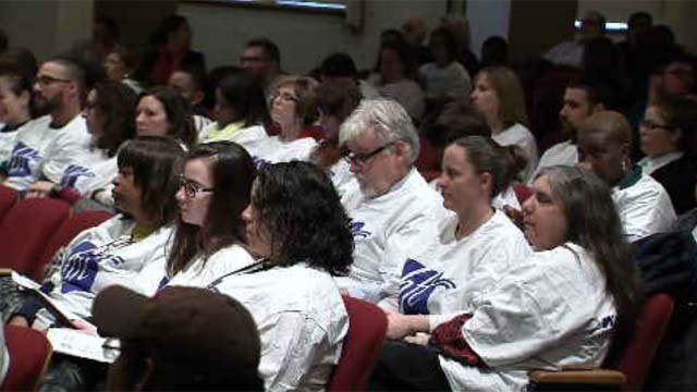 Parents and teachers were protesting layoffs and other proposed cuts being discussed at a meeting recently. (WFSB)