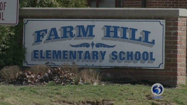 Trained dogs brought into Farm Hill Elementary School after bed bugs found in building. (WFSB)
