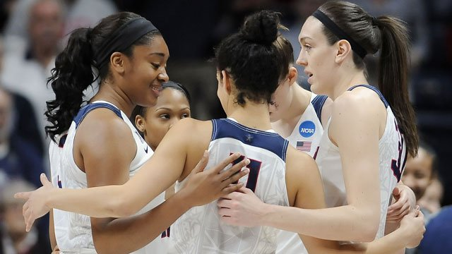 Connecticut players huddle together during a first round women's college basketball game against Robert Morris in the NCAA Tournament, Saturday, March 19, 2016, in Storrs, Conn. (AP Photo/Jessica Hill)