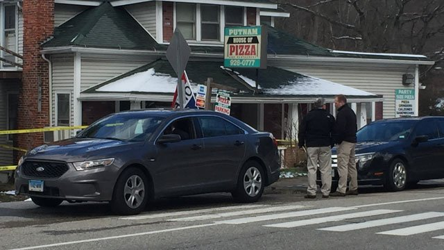 Police are investigating the discovery of a body outside of a pizza shop in Putnam. (WFSB)