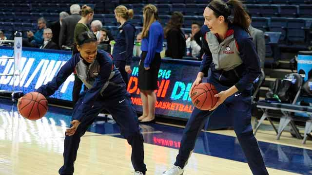 Connecticut's Moriah Jefferson, left, and Breanna Stewart share a playful moment during warmups before a second round women's college basketball game against Duquesne in the NCAA Tournament, Monday, March 21, 2016, in Storrs, Conn. (AP Photo/Jessica Hill)