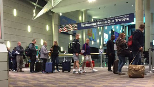 Travelers at Bradley International Airport said they were uneasy over the deadly explosions in Brussels Tuesday morning. (WFSB photo)