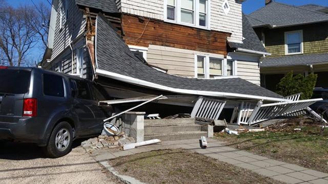 An SUV slammed into a home on Whitney Avenue Tuesday morning. (@HamdenFireDept photo)