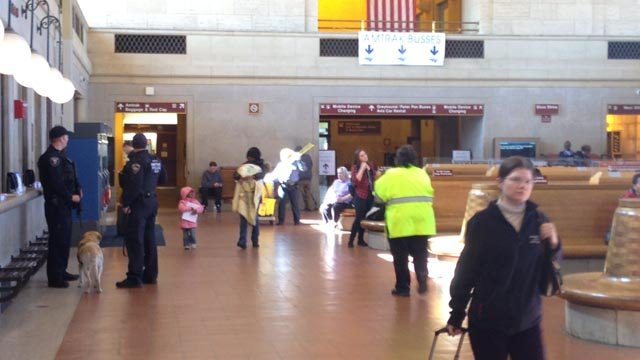 Extra security and a K9 unit patrol Union Station in New Haven following the attacks in Brussels. (WFSB photo)