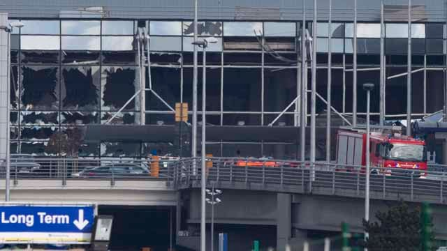 The blown out facade of the terminal is seen as a fire truck drives down the ramp at Zaventem airport, one of the sites of two deadly attacks in Brussels. (AP Photo/Peter Dejong)