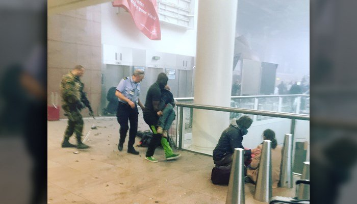 This photo provided by Georgian Public Broadcaster and photographed by Ketevan Kardava, shows the scene in Brussels Airport in Brussels, Belgium, after explosions were heard Tuesday. (Ketevan Kardava/ Georgian Public Broadcaster via AP)