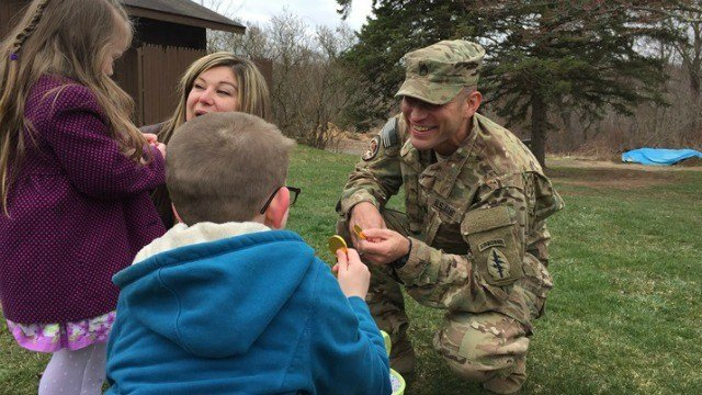 Sgt. First Class Michael Clark surprises his kids during Easter egg hunt. (WFSB)