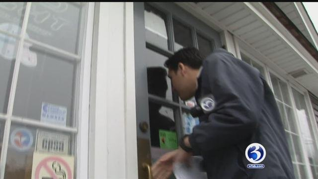 One store owner locked Eyewitness News out as we tried to get their side of the arrest. (WFSB)