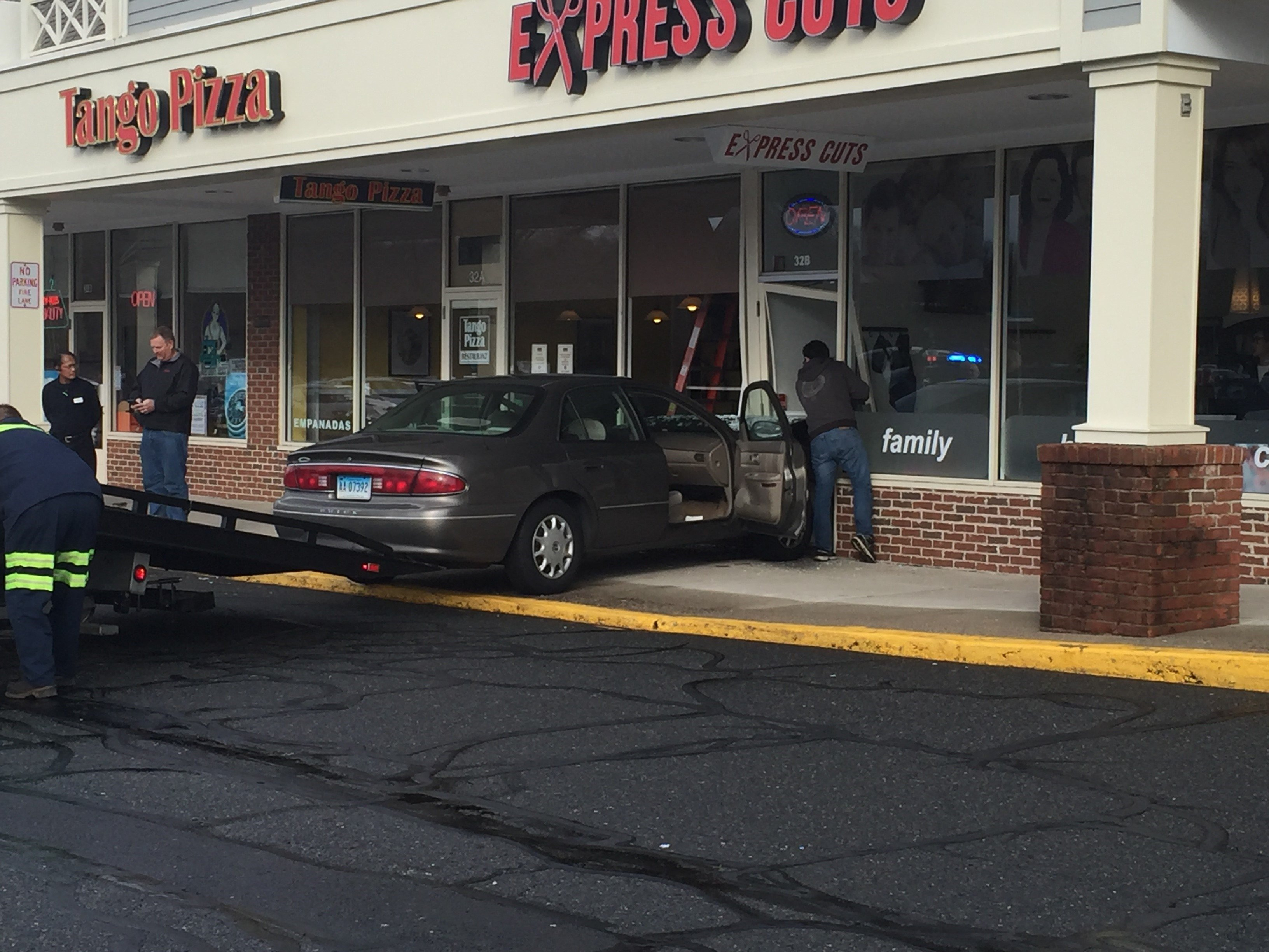 Police in Newington are investigating after a person drove into a building on Fenn Road on Monday afternoon. (WFSB)
