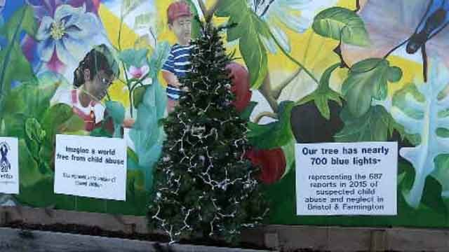 The Parent and Child Center held a blue ribbon tree lighting on Monday, ahead of the Child Abuse Prevention Month. (WFSB)