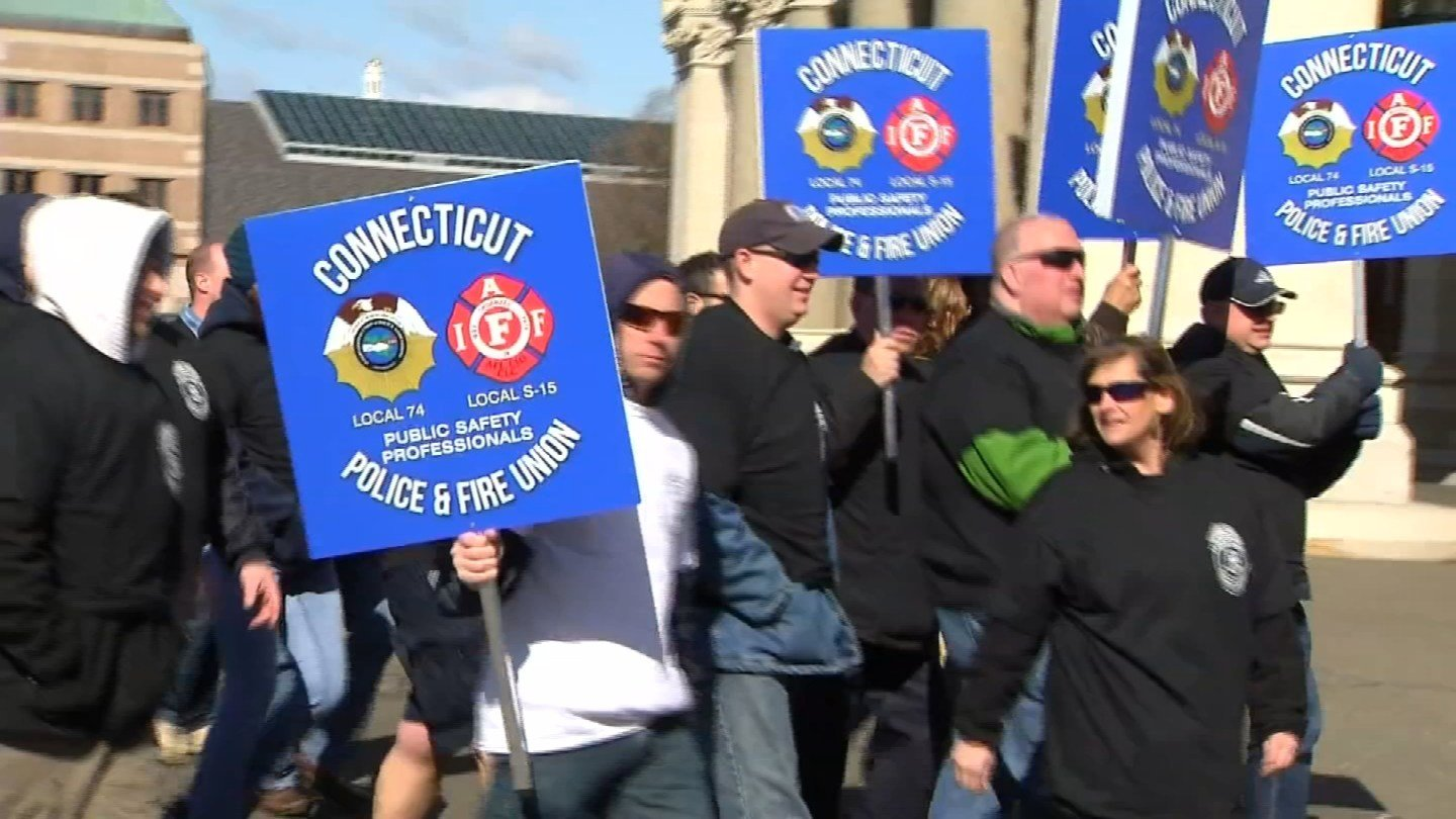 Public safety officers protested potential cuts on Tuesday. (WFSB photo)