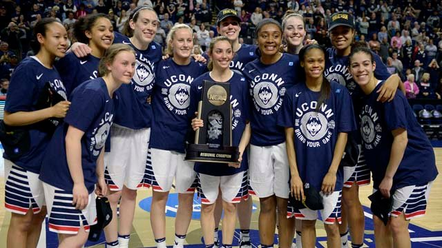 The UConn women's basketball team poses after punching a ninth straight trip to the Final Four. (AP photo)