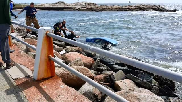 Good Samaritans, police rescued a woman from her car that was sinking into water on Thursday in Groton. (iwitness)