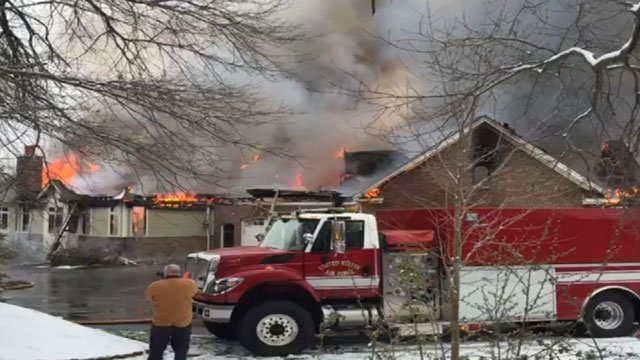 A home in East Granby was engulfed in flames on Monday morning. (WFSB)