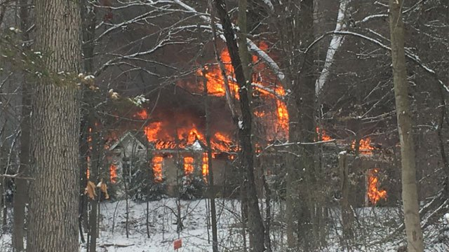 Firefighters battle house fire in East Granby. (Chris House)
