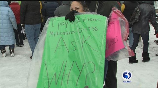 Nearly 100 union and private sector workers were rallying against budget cuts and layoffs. (WFSB)