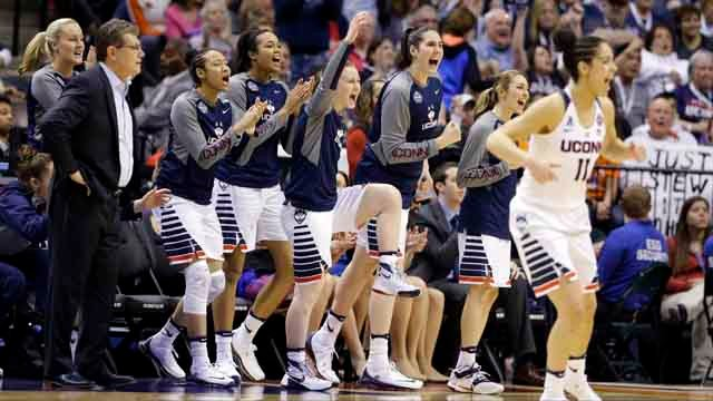 The Connecticut bench celebrates during the second half of the championship game against Syracuse, at the women's Final Four in the NCAA college basketball tournament Tuesday, April 5, 2016, in Indianapolis. (AP Photo/Michael Conroy)