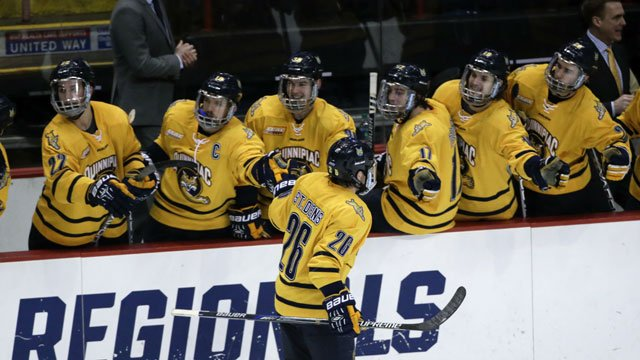 Quinnipiac's Travis St. Denis (26) celebrates his goal against UMass Lowell during the third period of the NCAA men's East Regional championship hockey game on Sunday, March 27, 2016, in Albany, N.Y. Qunnipiac won 4-1. (AP Photo/Mike Groll)