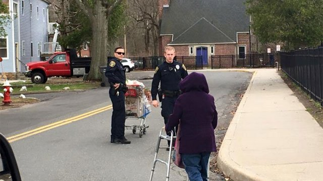 Officer walks for woman after a car crash. He brought her groceries to her home. (Naugatuck Police Department)