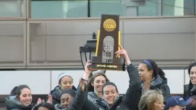 UConn Women's basketball team celebrates its victory holding the title. (WFSB)