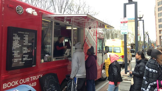Food trucks serve customers in New Haven on Monday. (WFSB)