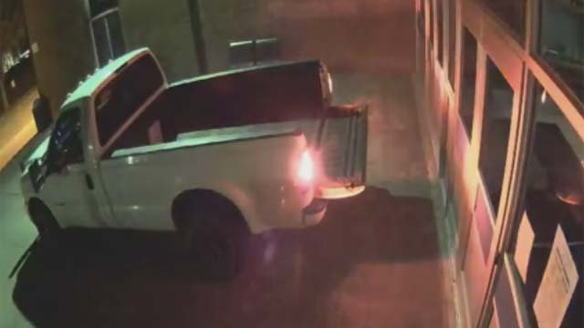 The video shows a white truck backing up in front of the entrance of the Morgan School. (Clinton Police Facebook)
