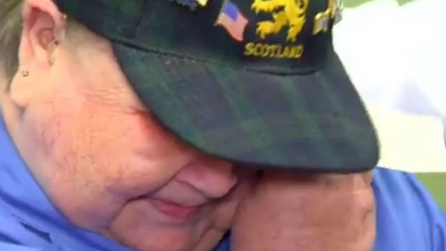 Scotty Clark cries after hearing for the first time in 15 years. (WFSB)