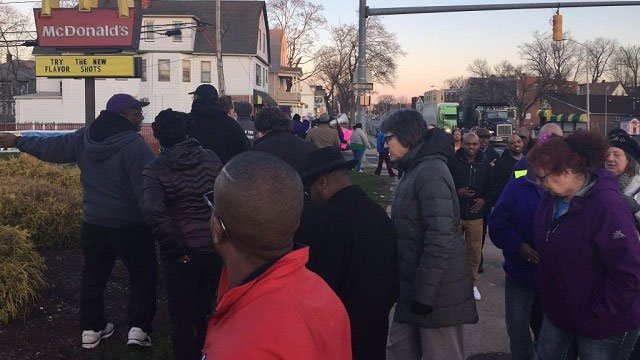 Dozens of workers gathered outside a Hartford McDonald's and rallied for higher wages on Thursday. (WFSB)