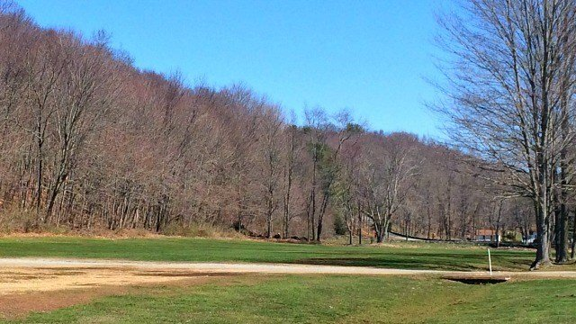 Trail system sits beyond the field of Maples Farm. (WFSB)