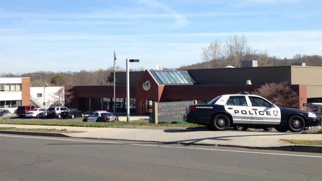 There's a large police presence at West Haven Post Office on Farwell Street following armed robbery on Thursday morning. (WFSB)