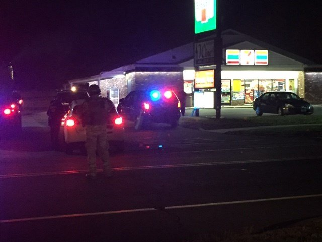 Officers remain outside the 7-Eleven in Newington after an overnight hostage situation.  (WFSB photo)
