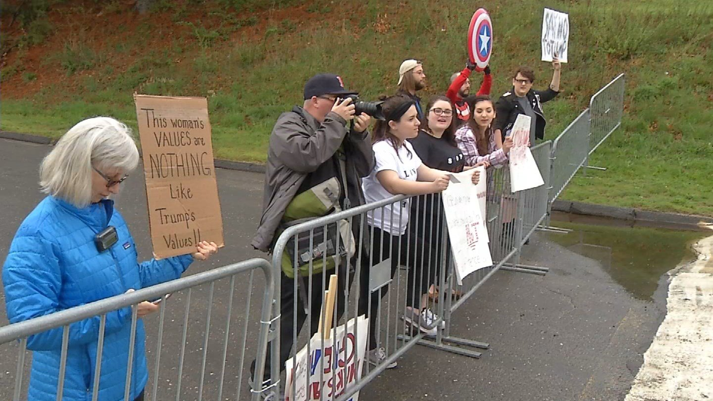 People lined up to protest Trump's visit on Saturday. (WFSB)