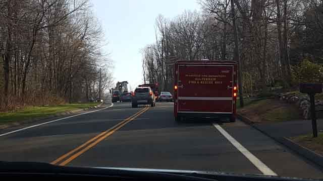 Several towns responded to a large brush fire in Bristol on Sunday afternoon. (WFSB)