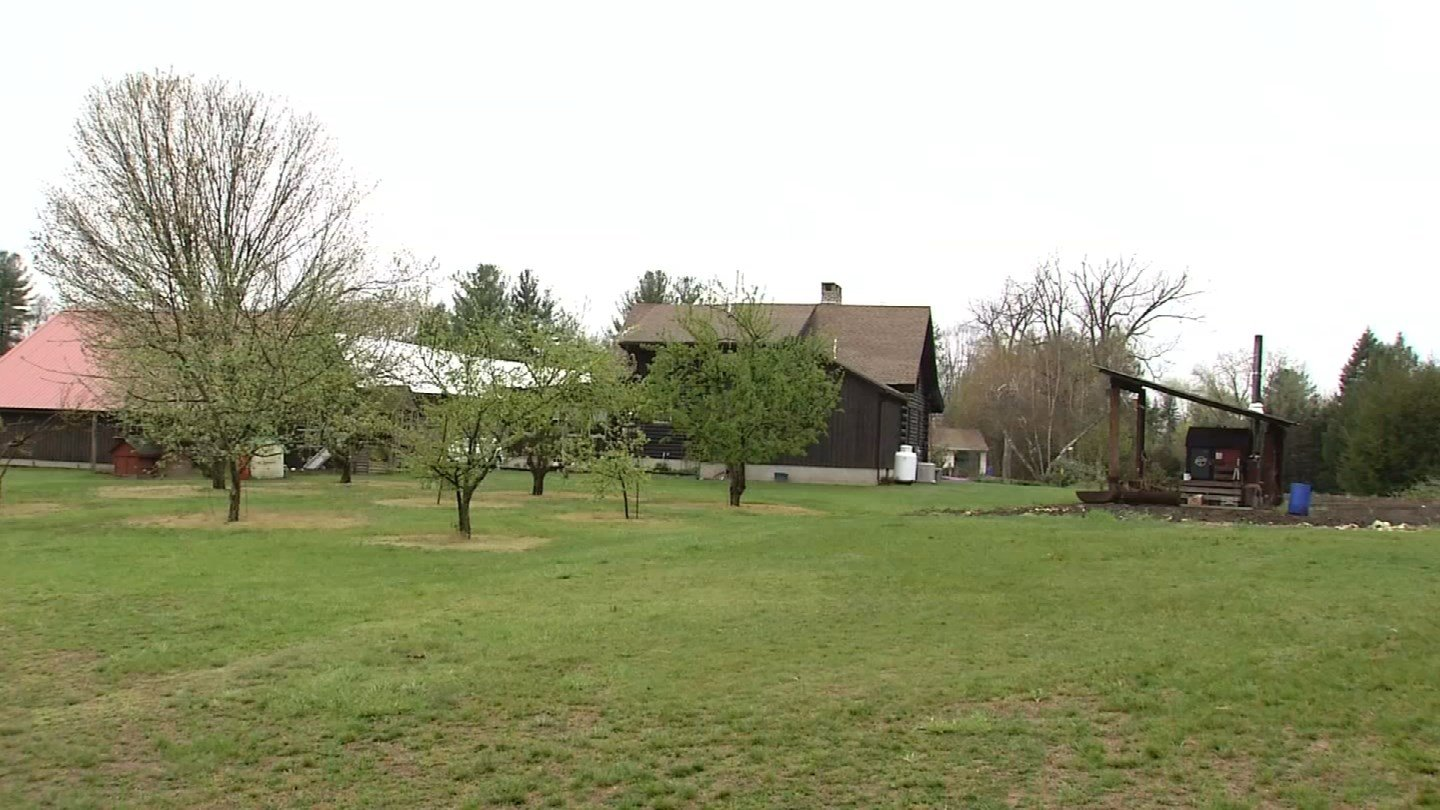 Enfield family said bullets are hitting their property. (WFSB)