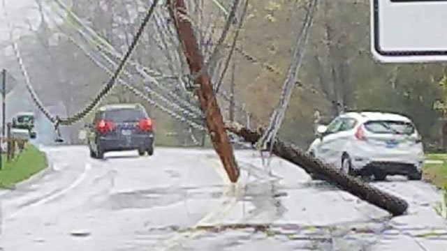 Downed utility pole and wires closed Route 189 in Granby.(Izzy)