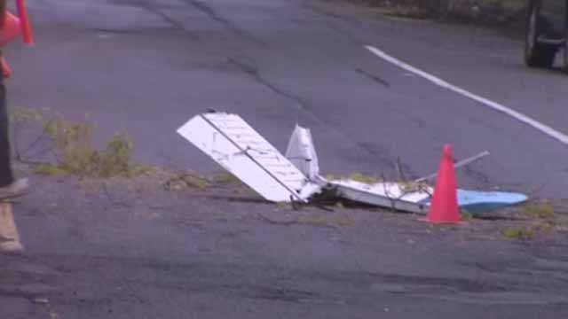 Officials say three people have been killed after a small plane crashed in a residential neighborhood on Long Island. (WCBS)