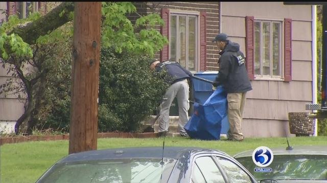 Mac 11 machine gun, two handguns, a silencer and ammunition were some of the items found in the Manchester home. (WFSB)