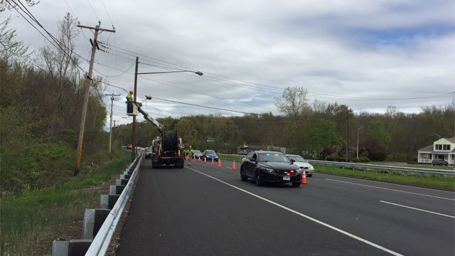 Crews were working on repairing utility wires after a crash. (WFSB)