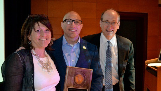 Jennifer Hensel and Dr. Jeremy Richman received an award for mental health research Sunday. (Yale University)