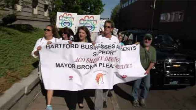 Dozens march in support of laid off Hartford animal control officer (WFSB)