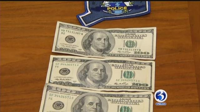 Police showed how hard it is to find a fake $100 bill. (WFSB)