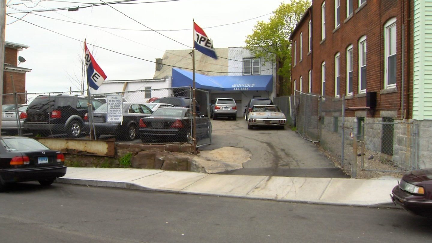 Johnny's Auto in New London is under investigation by the DMV. (WFSB photo)