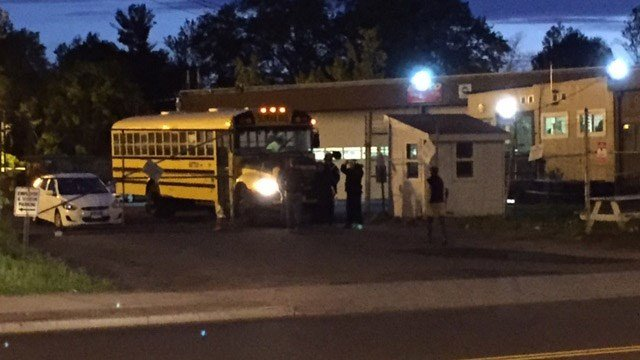Protesting Dattco drivers attempt to prevent a bus from leaving early Tuesday morning. (WFSB photo)