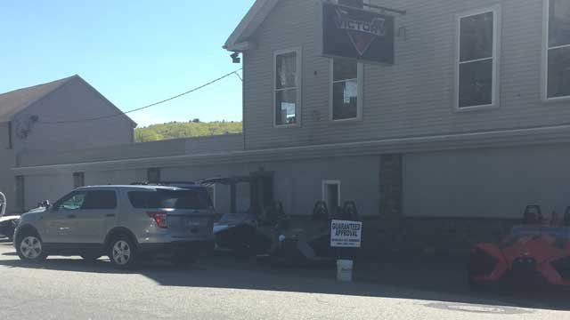 Investigators were seen going in and out of the Shark Cycle building (WFSB)